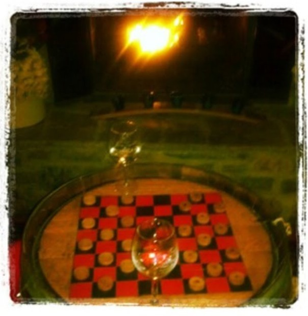 Our awesome checker board next to one of the fire places!