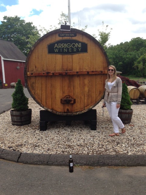 I also forced Kate to get in this picture.  She refused to hold the wine bottle as well, but I put it in front of the barrel.  Who's laughing now??