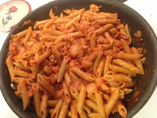 meat and onions with pasta