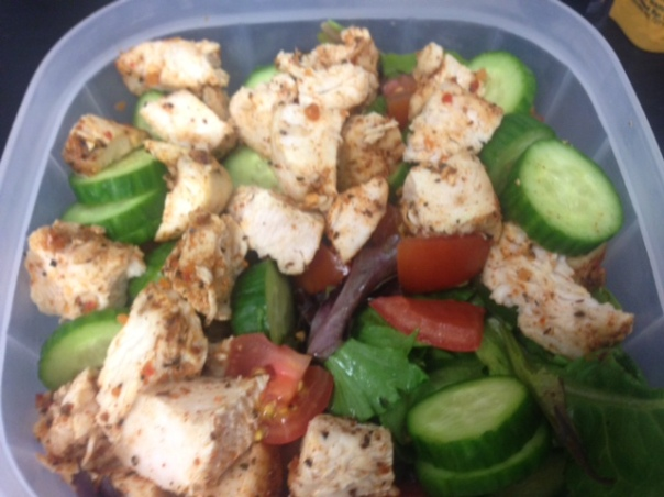 Lunch:  organic greens, cucumber, tomato, and chicken.  I drizzled some balsamic vinegar and flaxseed oil on there...delicious.